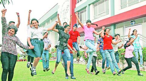 Students after scoring 10 CGPA marks in CBSE class X examination, at a school in Chandigarh on  Tuesday. ( Source: Express photo by Jasbir Malhi )