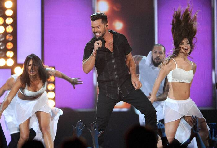 Ricky Martin performs on stage at the Billboard Music Awards. (Source: AP)