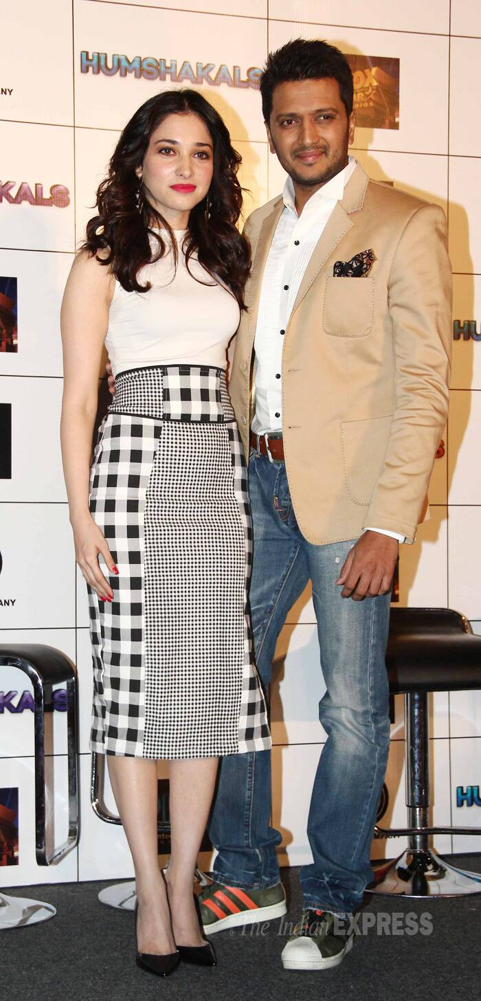 Tamannah was stylish in a white blouse with a monochrome Nasty Gal pencil skirt and black pumps as she posed for pictures along with Riteish Deshmukh. (Source: Varinder Chawla)