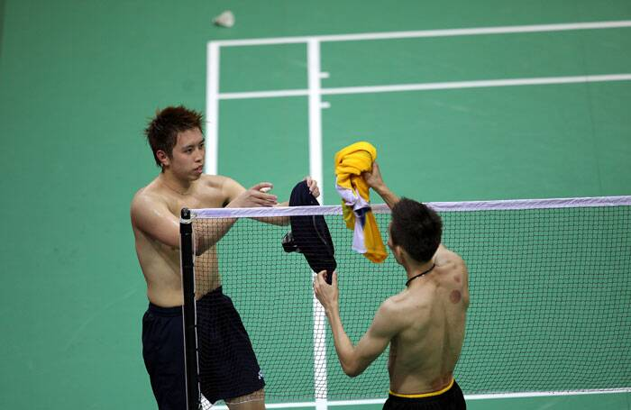 Lee Chong-Wei and Kenichi Tago exchange their shirts after their Thomas Cup final clash. (Source: IE Photo Ravi Kanojia)