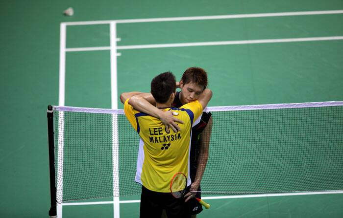 Lee Chong-Wei hugs Kenichi Tago after their Thomas Cup final match at the Siri Fort Sports Complex in Delhi on Sunday. (Source: IE Photo Ravi Kanojia)