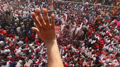 People wave from rooftops in show of support for Samajwadi Party. (Neeraj Priyadarshi)