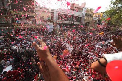 Supporters wave at Akhilesh Yadav's roadshow in Varanasi. (Neeraj Priyadarshi)