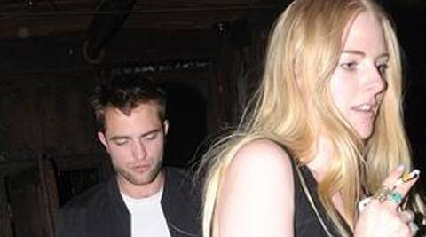 Robert Pattinson was spotted hanging out with a mystery blonde. (photo: Twitter)