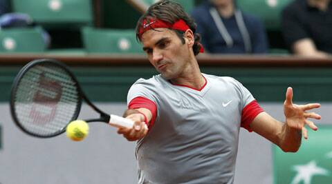 Roger Federer hits a return to Lukas Lacko of Slovakia during their men's singles match at the French Open on Sunday. (Source: Reuters)