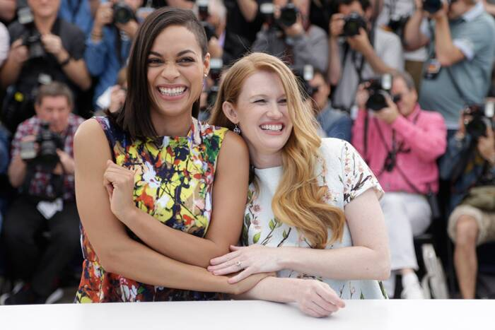 The girls – Rosario Dawson and Mireille Enos flash wide smiles for the cameras as they pose for pictures. (Source: AP)