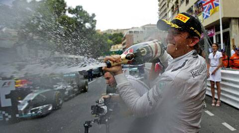 Nico Rosberg sprays champagne after winning the Monaco Formula One Grand Prix, in Monaco on Sunday. (Source: Reuters)