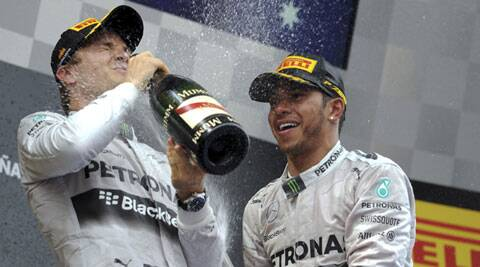 Second placed Mercedes Formula One driver Nico Rosberg (L) and winner Lewis Hamilton spray champagne after the Spanish F1 Grand Prix in Montemlo on Sunday. (Reuters)