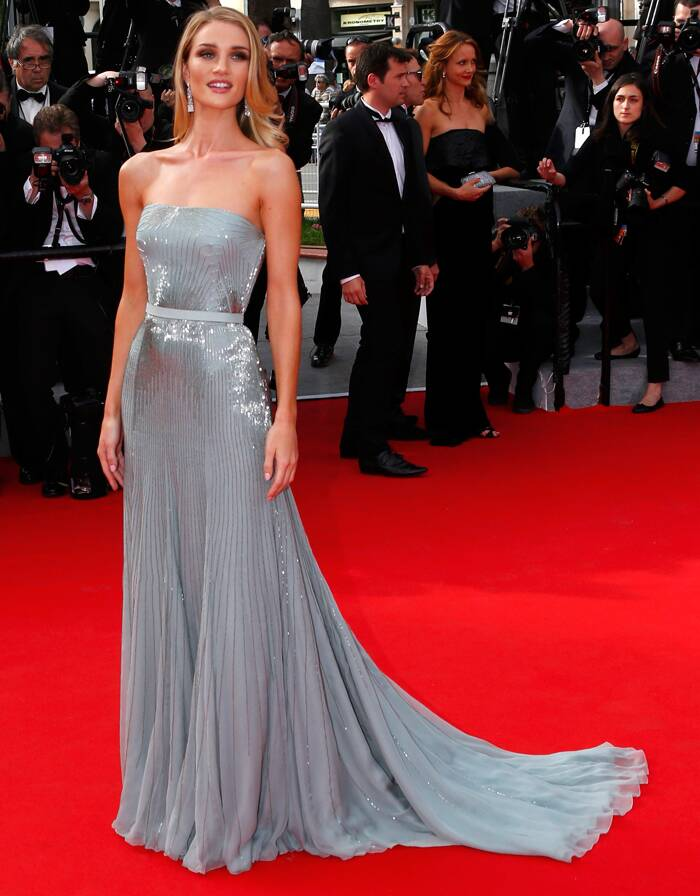 Victoria's Secret model Rosie Huntington-Whiteley went ultra-glam in a beautiful silvery-grey Gucci gown as she posed for the media on her arrival for 'The Search'. (Source: Reuters)