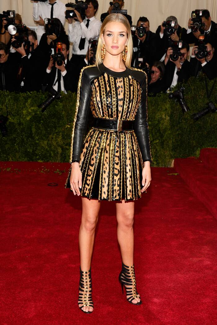 Rosie Huntington-Whiteley was edgy in a short Balmain dress and shoes. (AP)