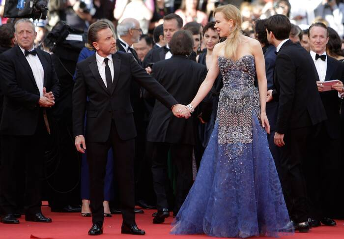 Nicole snapped hand-in-hand with her co-star Tim Roth, who plays the role of Monaco's Prince Rainier III as they arrive for the 67th Cannes Film Festival and the screening of the 'Grace of Monaco'. (Source: AP)