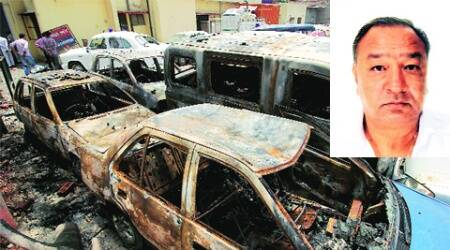 Manmohan Goyal whose killing sparked violence; remains of the torched vehicles.
