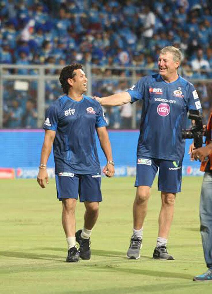 Sachin Tendulkar and Mumbai Indians coach John Wright can't stop smiling after their team's maiden victory in the ongoing Pepsi IPL tournament in Mumbai on Saturday. (IE Photo Prashant Nadkar)