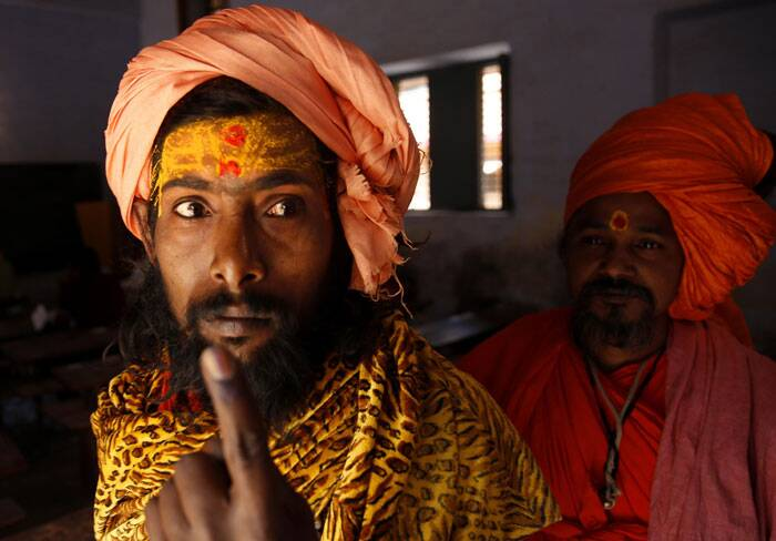 A sadhu shows his inked finger after casting his vote in Haridwar. (AP)
