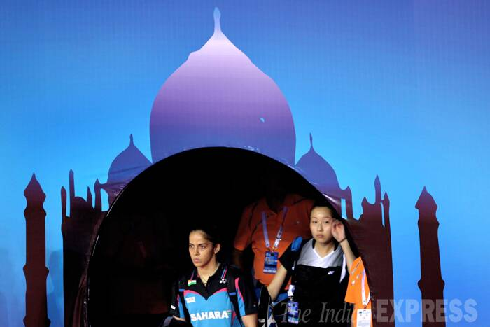 After guiding the women's team to a thumping victory in the Uber Cup, Olympic bronze medallist Saina Nehwal said her confidence is still not at the peak but she is slowly finding her rhythm back. <br /><br />  Saina Nehwal of India and Ko Joycelyn of Canada wait to enter before start women singles, on Day 1 of Thomas and Uber cup finals 2014 at Siri fort sports complex, in New Delhi. (Source: Express photo by Ravi Kanojia)