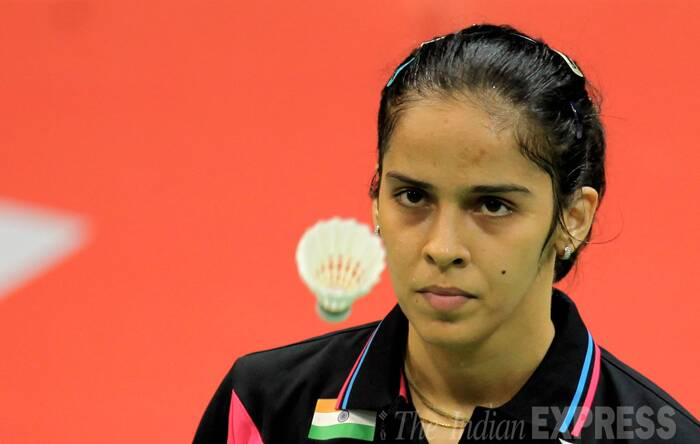 "Asked if she was 100 percent fit, Saina said:""Nobody can say a player is 100 percent. Everyone is here and there and I think it is about how you find your rhythm and how good you play in that tournament and it is just starting. So lets us just wait for other matches and see how it goes."" Saina said she was finding it a bit difficult to control the shuttle in the second game as there is drift in the stadium.(Source: Express photo by Ravi Kanojia)"