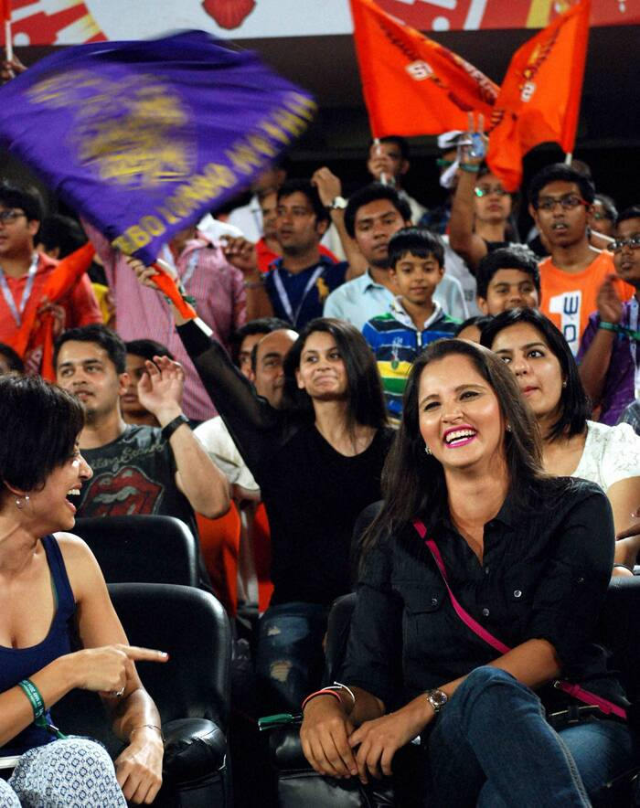 Hyderabadi girl and ace Tennis player Sania Mirza was seen cheering for Sunrisers Hyderabad team at the ongoing IPL 7 on Sunday (May 19). Sania, who stays in Dubai with her Pakistani cricketer husband Shoaib Malik, was casual in black shirt, blue jeans but it was pink lip colour that caught everyone's attention. (PTI)
