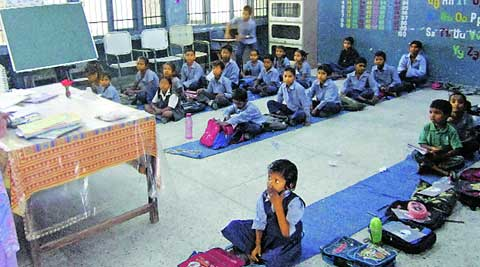 Students sit on the floor at a government school  in Mohali. (Gagandeep Singh Dhillon)