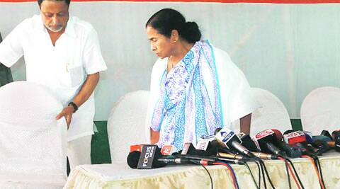 TMC leader Mukul Roy offer the chair to part chief Mamata Banerjee during her press meet at her residence in Kolkata Friday. ( Source: Express photo by Subham Dutta )