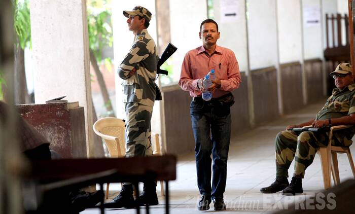 A paramilitary personnel stands to guard the counting booth in Vadodara on Thursday. (Source: Express Photo by Bhupendra Rana)
