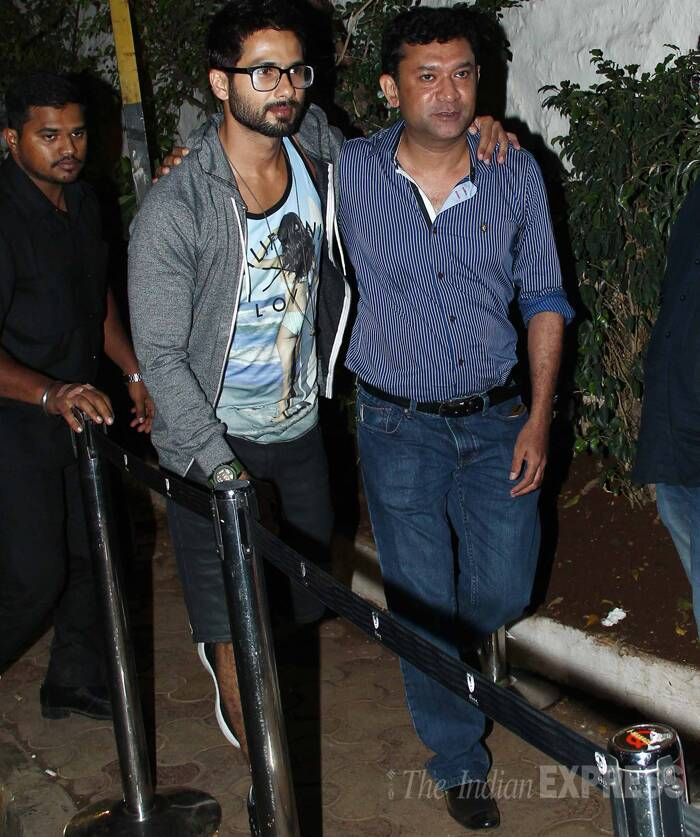 Shahid Kapoor was dressed in a tee featuring a bikini girl, a grey jacket and jeans. Seen here, the actor makes his arrival with filmmaker Ken Ghosh. (Photo: Varinder Chawla)