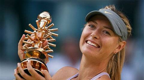 Maria Sharapova celebrates her victory holding her trophy during a Madrid Open tennis tournament final match against Simona Halep from Romania in Madrid on Sunday. AP