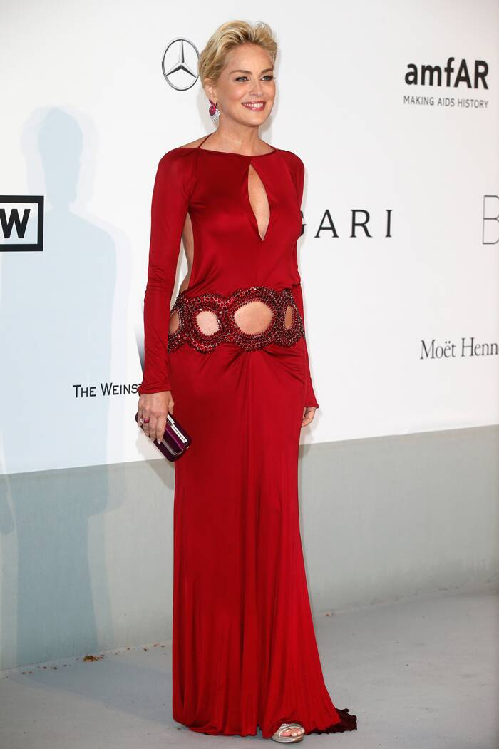Sex symbol Sharon Stone wasn't afraid to show some skin in a cutout cherry coloured gown by Roberto Cavalli as she attended the amfAR Gala. (Source: Reuters)