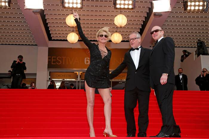 Sharon Stone waves to the crowd as she poses on the red carpet with Cannes Film festival general delegate Thierry Fremaux. (Source: Reuters)