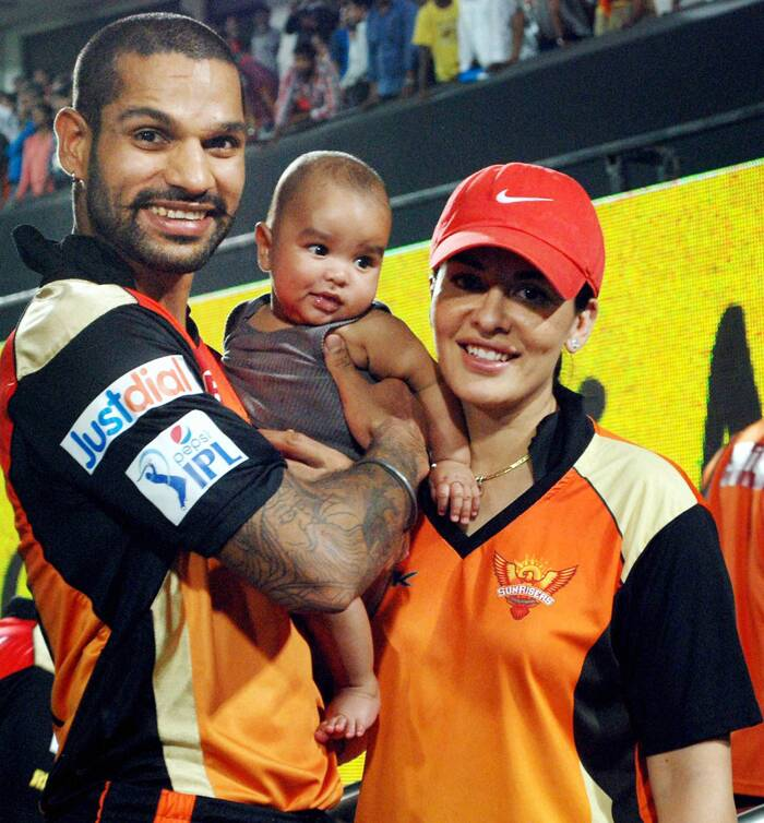 Shikhar Dhawan was also seen posing with his li'l one and wife Ayesha at the IPL 7 match between Royal Challengers Bangalore and Sunrisers Hyderabad at Uppal Stadium in  Hyderabad on Tuesday. (PTI)