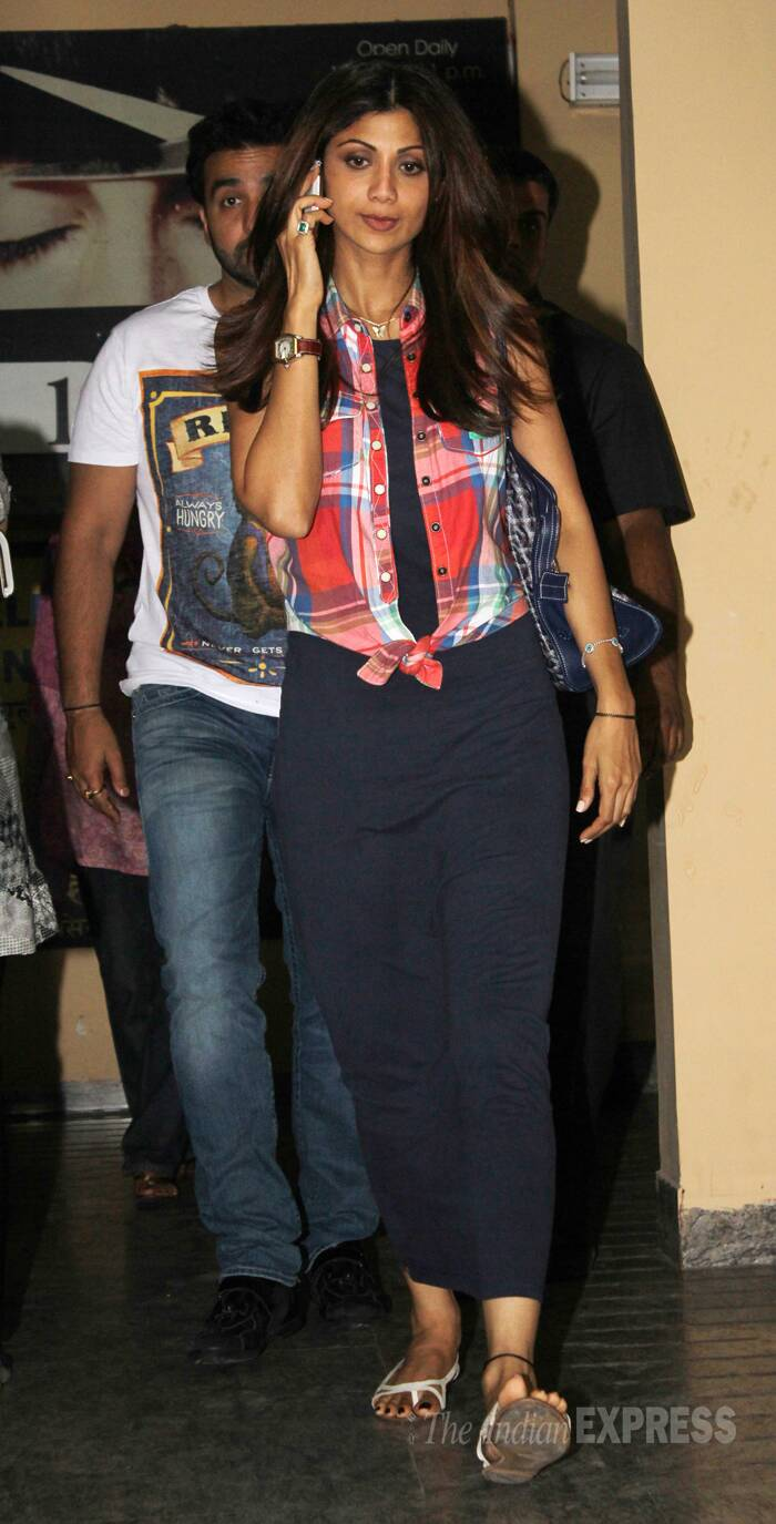 Shilpa Shetty was continuously busy over the phone while Raj walked behind her. (Photo: Varinder Chawla)