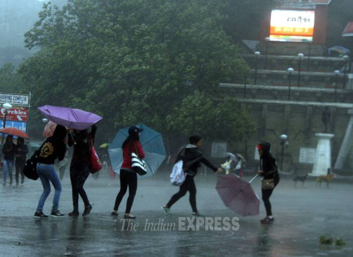 Girls enjoy in the rain shower in Shimla on May 12. ( Source: Express photo by Lalit Kumar)