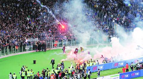 Napoli fans threw flares and clashed with police ahead of the Italian Cup final, leaving three injured. The match was delayed by 45 minutes. AP
