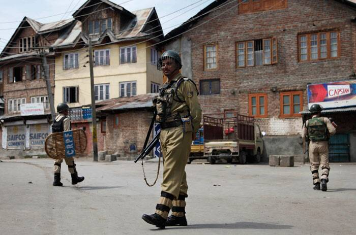 Paramilitary soldiers patrol a street during curfew in Srinagar. <br />The spokesman said curfew has been clamped as a precautionary measure to maintain law and order. (AP)