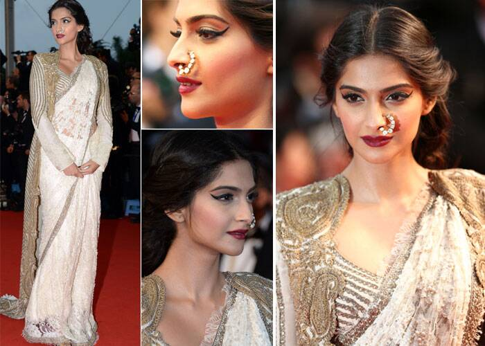 Sonam Kapoor decided to go traditional at the screening of The Great Gatsby during Cannes 2013. She opted for a lace sari by Anamika Khanna and embroidered jacket. What stood out in this look of hers was the pearl nathni which she pulled off well.
