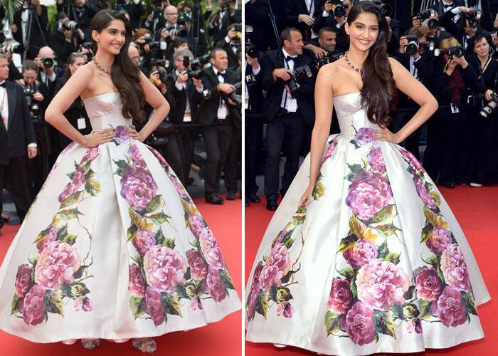 It was a floral strapless Dolce & Gabana printed dress at Cannes 2013 that was a show stealer. Her side swept hair and a necklace completed her look.