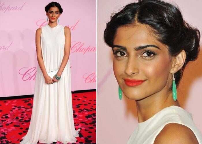 Sonam Kapoor was next seen in The Row white gown with Lieber clutch and Ferragamo shoes for the photocall of the Chopard's party at Cannes Film Festival in 2011.