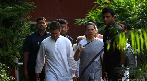 Congress President Sonia Gandhi and Vice President Rahul Gandhi on their way to address the media after its poll debacle.  (Source: Express photo by Oinam Anand)