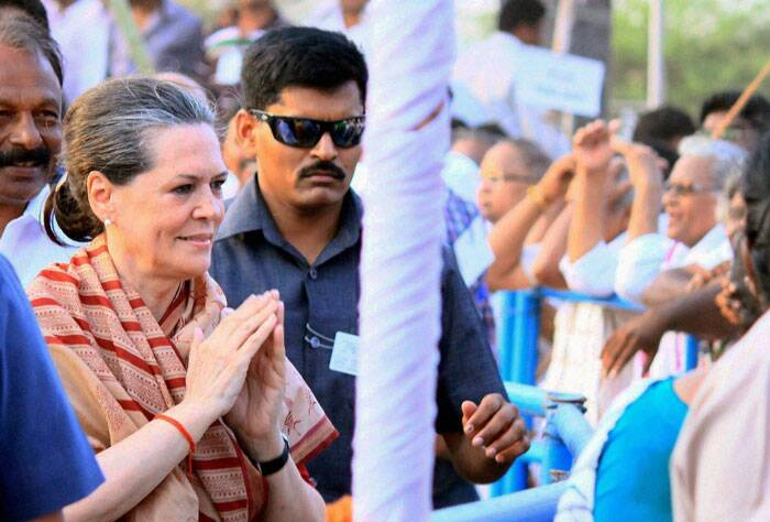 Congress President Sonia Gandhi meeting people at an election campaign meeting in Guntur on Friday. (PTI)