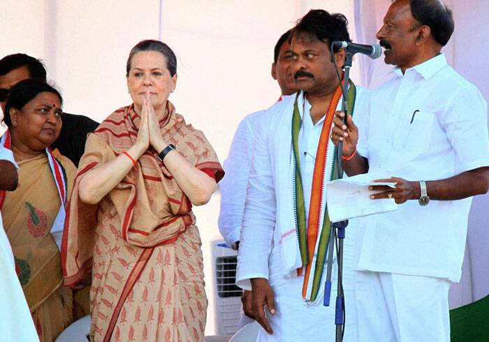 Congress President Sonia Gandhi along with APCC chief Raguveera Reddy, Tourism Minister K Chiranjeevi and former minister Panbaka Lakshmi at an election campaign meeting in Guntur on Friday. (PTI)