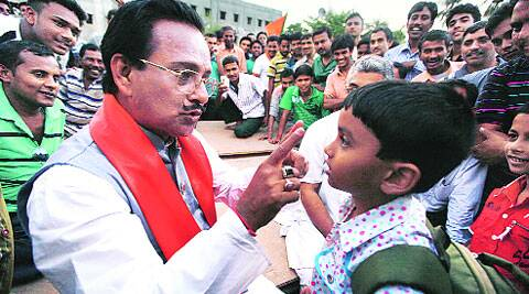 P C Sorcar enchants a child with his magic; he teaches some a trick or two. (Subham Dutta)