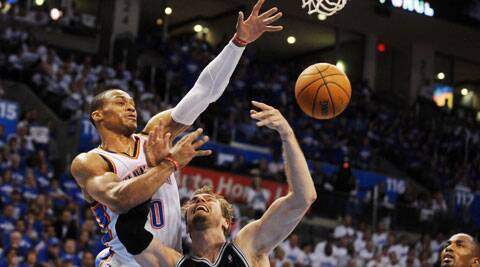 San Antonio Spurs center Tiago Splitter attempts a shot against Oklahoma City Thunder guard Russell Westbrook. (Source: USA Today Sports)