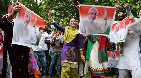 BJP supporters dance as they celebrate the party's win in Lok Sabha polls, in Srinagar on Saturday. (Source: PTI)