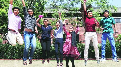 Class XII students celebrate after the results. Javed Raja