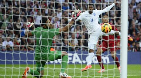 England's Daniel Sturridge takes a shot at the goal as Peru's goalkeeper Raul Fernandez (L) looks on during their international friendly game in London on Friday. (Source: Reuters)