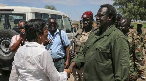 United Nations High Commissioner for Human Rights Navi Pillay, left, shakes hands with South Sudan's former Vice President and now rebel leader Riek Machar, right, at an undisclosed location in South Sudan. (AP)