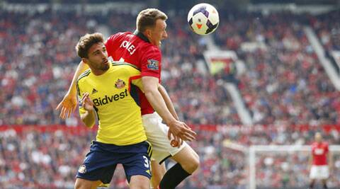 Phil Jones (R) of Manchester United and Fabio Borini of Sunderland fight for the ball during their English Premier League tie at Old Trafford on Saturday. (Reuters)