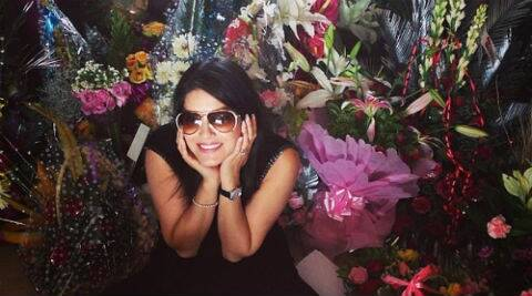 Sunny Leone looks thrilled as she sits among all her birthday bouquets. (Source: Twitter)