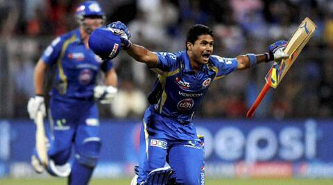 Mumbai's Aditya Tare hit a six off James Faulkner to help the side qualify for the IPL 7 playoffs. (Source: PTI)