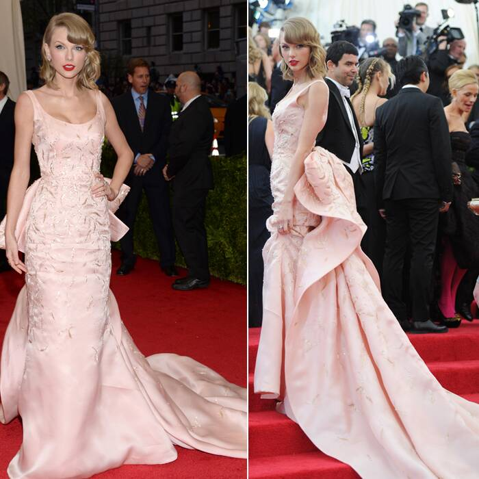 Taylor Swift went for a more theatrical look – pale pink satin Oscar de la Renta with a long train. (AP)