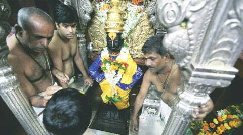 Priests perform rituals at Vitthal Rukmani temple in Pandharpur